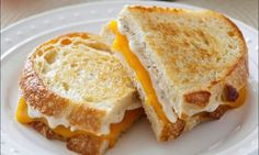 A great upgrade to a lunchtime classic. Add Garlic Parmesan spread to this Grilled Cheese Sandwich #Recipe. Also sub in meats & veggies for variety!