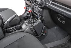 One of the most important off-road accessories is a CB radio. The Quadratec Quick Disconnect CB Radio Mount allows you to easily mount a CB radio on the passenger side of your Jeep's center console. This kit was specifically designed to mount to the Wrangler JL, and it reuses factory bolt holes.