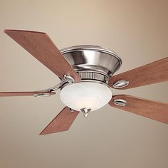 Make a living room, foyer, bedroom, or other area more welcoming with this handsome Minka ceiling fan.