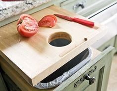 Expand your kitchen counters by creating a pull-out cutting board. A trash chute makes it super easy to toss food scraps. While this craft adds counter space for chopping and meal prep, it tucks away when its not in use.