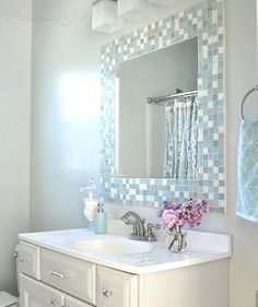 subtle mosaic tiles around the mirror