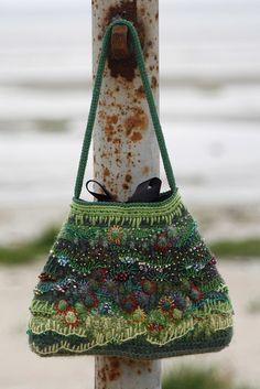 "Inspiration - Flickr, designed by MarianneS...  crocheted and embroidered purse...post st as background, bobbles as ""flowers""...embroidery includes blanket st around bobble ""flowers"", the background ""grass"" and beading for added texture...exquisite work"