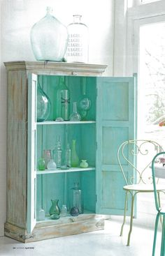 Well prsented collection of coloured glass, from Ariadne at Home magazine.  Styling Linda van der Ham Photo Louis Lemaire