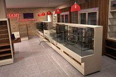 طراحی و تجهیز فروشگاه زنجیره ای حامی- ولنجک -ارائه دکوراسیون فروشگاهی، کانتر شیرینی، یخچال شیرینی و ...