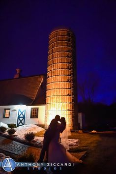 Nighttime shot of the happy couple posing by the Barn silo.  #PeronaFarms #bride #groom #love #happycouple #anthonyziccardistudios @AZiccardi