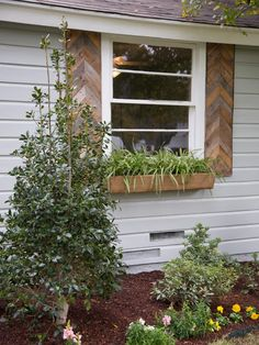 Joanna loves to add life to a home with lots of plants. No green thumb? No worries! Here, the crew added rustic windowboxes filled with easy-to-care-for spider plants.