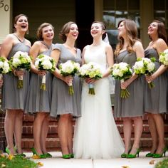 Katharine and Mike: The bridesmaids wore gray dresses in different styles with a bright green heel. Their bouquets by Roostervane Gardens reflected the bride's in both color and flowers. Image Credit: Maria Linz Photography
