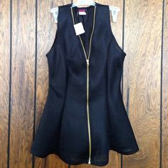 Holiday's perfection Gorgeous mesh material peplum top with gold zipped details. Blush Jackets & Coats Vests