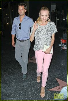 """Diane Kruger & Joshua Jackson: Katsuya Couple! a pair of light pink pants and Current/Elliott's The Freshman Tee in Grey Leopard with Bally """"Rouleaux Stredas"""" heels."""