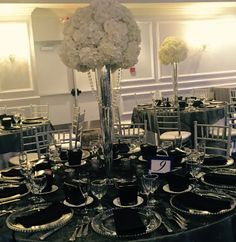 White Toppers; Crystals; silver Pilsner vases; hydrangea; roses; centerpiece; designs by @jasmine_galleria