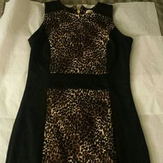 Michael Kors leopard dress Black dress with brown/cream leopard print panels.  Gold zipper back. Ponte mayerial. Thich,stretch mayerial that barely wrinkles. Worn a few times. In very good condition! Michael Kors Dresses