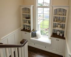 stairway window seat... again I don't want to have stairs but I LOVE this