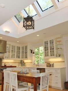 Skylights in living room flat ceiling with attic for Must have kitchen ideas