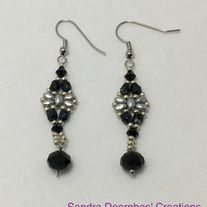 """Made+with+silver+super+duos+and+silver+mini+duos,+black+crystal+beads,+black+fire+polish+glass+beads++and+silver+glass+seed+beads.+Made+with+silver+plated+non+tarnish+hypoallergenic+materials.++2+1/2"""""""