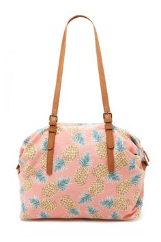71f038026606 A large canvas bag featuring an allover pineapple print