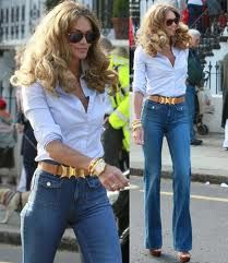 Elle in high waist jeans and bouncy hair