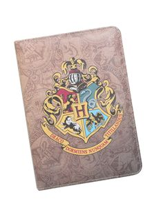 "Mini universal tablet case from <i>Harry Potter</i> with a Hogwarts crest design. Fits most small tablets. How? Magic. And elastic strap corners.<br><ul><li style=""list-style-position: inside !important; list-style-type: disc !important"">5 1/2"" x 8""</li><li style=""list-style-position: inside !important; list-style-type: disc !important"">Imported<br></li></ul>"