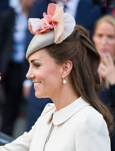 Duchess Kate's best ever hairstyles - The queen of headwear, Kate has mastered the art of styling hair around a floral fascinator.