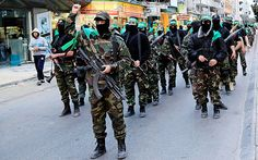 Palestinian militants of a military wing of Hamas, take part in a parade in Gaza Join https://www.facebook.com/pages/Israel-Information-Center-Ithaca/1513322575572798