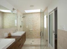 Floating vanity, large mirror with simple lighting, pocket door.  Look familiar? COLBY RESIDENCE by MEDIUM PLENTY