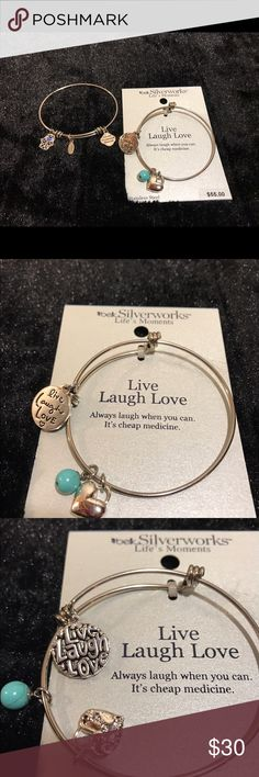 Life memories bracelets by Belks This is Silverworks Life's Moments bracelets by Belk. The first bracelet still in the package is live laugh love it has a charm on it that says live laugh love, a heart charm on it and a turquoise bead. The other bracelet that was worn once or twice has a girl on it with a blue heart and another charm that says loved, protected, blessed. They are stainless steel bracelets 8 inches and have a polished finish. Very cute bracelets you can dress them up dress…