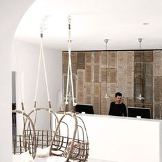 Louvered cupboard doors on back wall and swing seating at the San Giorgio Hotel Mykonos, Member of Designhotels: Photos