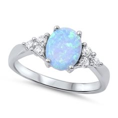 The simulated light blue opal adorns the center of this carefully crafted ring. This ladies light blue opal and CZ ring will arrive in a beautiful jewelry gift box. Morganite Engagement, Engagement Ring Settings, Diamond Engagement Rings, Solitaire Diamond, Wedding Engagement, Pearl Diamond, Gold Pearl, Wedding Rings, Wedding Bells