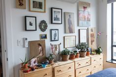 love this actual gallery wall (not just a small gallery taking up space on the fuller wall of a room)