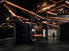 ONE PLUS Partnership designed this cinema to pay homage to the movie industry, by creating a copper track, similar to those used when filming a tracking shot, that runs throughout the lobby and even in some of the theaters.