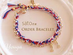 *Color bracelet* satoさまオーダーありがとうございます♪トリコロールカラーの紐で編み、メイン部分にチャームを2つつけさせて頂きました☆留め...|ハンドメイド、手作り、手仕事品の通販・販売・購入ならCreema。 Creema, Charmed, Bracelets, Handmade, Jewelry, Necklaces, Hand Made, Jewlery, Jewerly