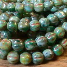 6mm green stone Picasso fluted melon beads.