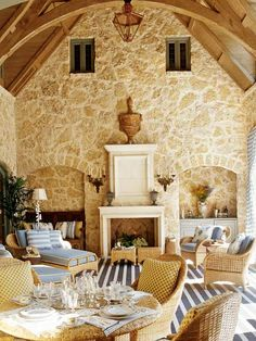 To set a cheerful tone in this air-conditioned loggia, the designer used complementary fabrics in blue and white and accents of provincial yellow. (Photo: Photo: Antoine Bootz and Jeff McNamara; Designer: Cathy Kincaid)