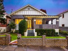 Brick californian bungalow house exterior with brick fence & hedging - House Facade photo 522973