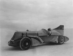 "Ab Jenkins sitting inside his ""Mormon Meteor"" on the Bonneville Salt Flats, late 1930s."