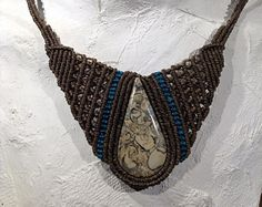 The necklace is made with natural materials. We apply the technique of macramé and use waxed thread (very strong and special material to