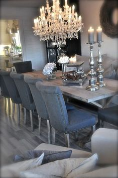 grey chairs around rustic dining table