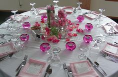 Petals - Instead of pink imagine purple petals. Cheap and easy way to add color to tables.