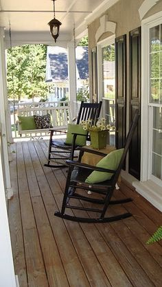 front porch - need to add pillows to our outdoor rocking chairs, love this idea...as long as our dog leaves them alone?! and adding a little table would be cute!