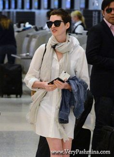 #AnneHathaway Departs Miami In A Light #BeigeScarf