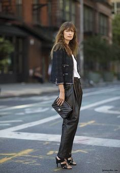 Wide leather pants and tweed jacket. Laceup shoes.