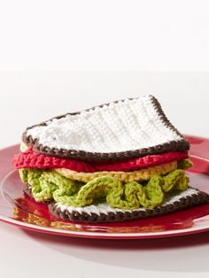 Use your lunch break to crochet your lunch with this clever crocheted sandwich pattern from Yarnspirations! This project is a perfect gift for someone who might be planning an imaginary tea party. Crochet Food, Cute Crochet, Crochet For Kids, Crochet Dolls, Crochet Yarn, Crochet Cupcake, Crochet Fruit, Crocheted Toys, Crochet Toddler