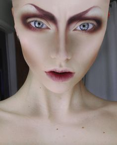 Creepy but in a good way. Would love to do a shoot of someone with weird alienesque makeup like this.