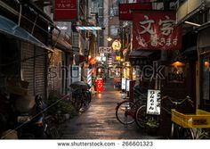 OSAKA, JAPAN - MARCH 7, 2015: Namba back alley at night in the rain.