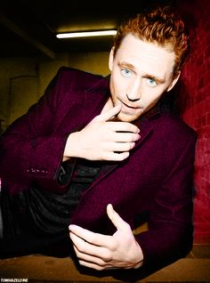 Hiddles in a shiny purple jacket. Adorable!