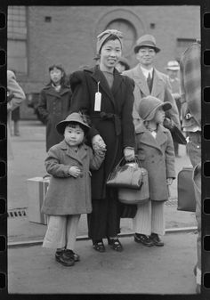 Japanese-American family waiting for train to take them to Owens Valley as part of the evacuation of Japanese-Americans from West Coast areas under U. Army war emergency order, Los Angeles, California, April 1942 by Russell Lee. Japanese American, Asian American, World History, World War Ii, Vintage Photography, Family Photography, American Splendor, Grapes Of Wrath, Ghost In The Machine