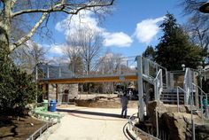 To enter the zoo and learning center, guests walk under an overhead goat bridge,