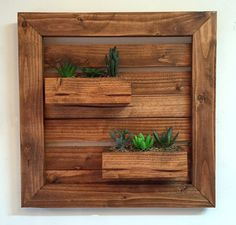 Rustic wall planter with artificial succulents by TreetopWoodworks