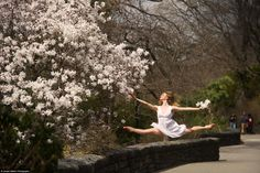 Claire Stallman in NYC Central Park, with flowering Magnolia stellata tree, by Jordan Matter Photography.