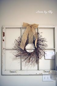 Window frame with wreath and burlap bow to cover the thermostat