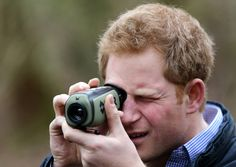 Prince Harry uses a thermal imaging camera as he meets staff from Red Squirrel Northern England (RSNE) who are working with the local community to safeguard the red squirrel (Sciurus vulgaris) population, with the main focus on a grey squirrel (Sciurus carolinensis) control programme at Frankham Woods near Fourstones